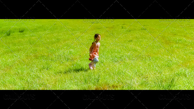 Girl walking with Berry Basket on Green Grass Fields