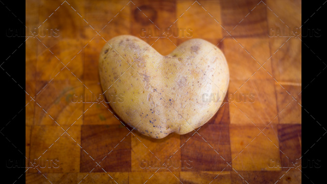 Heart Shaped Potato on Cutting Board