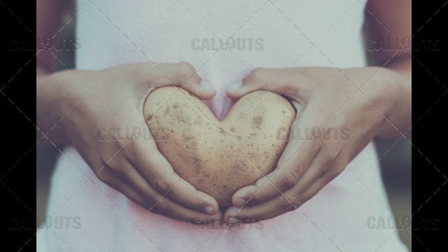 Heart Potato Held by Stomach