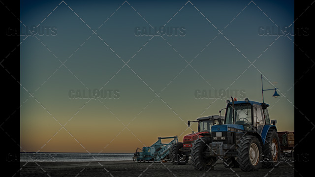 Tractors on Beach at Sunset