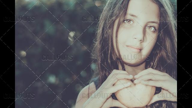 Girl holds Heart-Shaped Potato