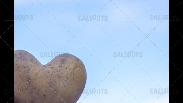 Heart Shaped Potato on Blue Sky