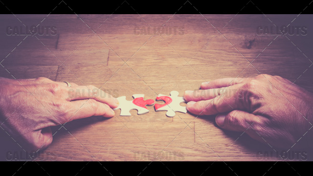 Hands Putting Love Puzzle Together