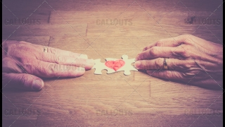Hands Finalizing Love Puzzle Together