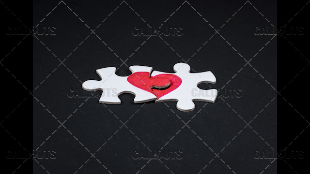 Heart Puzzle Final Pieces Together on Black