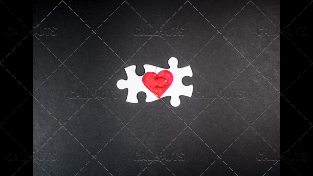 Heart Puzzle Final Pieces Together on Black Top-Down
