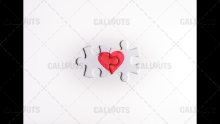 Heart Puzzle Final Pieces Together on White Top-Down