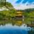 Wider shot of The Golden Pavilion, Kinkaku-ji, a Zen Buddhist temple, Kyoto, Japan