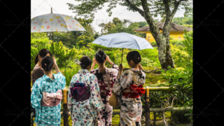 Japanese tourists dressed in traditional kimono dresses visiting tourist attraction