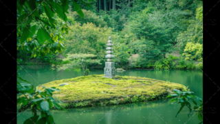 Stone pagoda on small island, in lake or pond