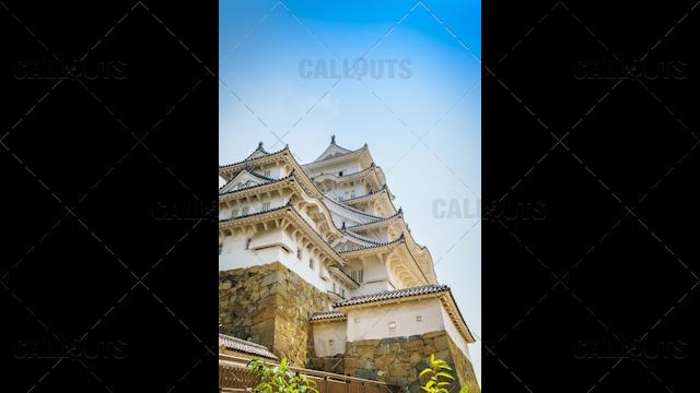 Himeji Castle, a hilltop Japanese castle by the city of Himeji, Hyōgo Prefecture, Japan. Low Angle.