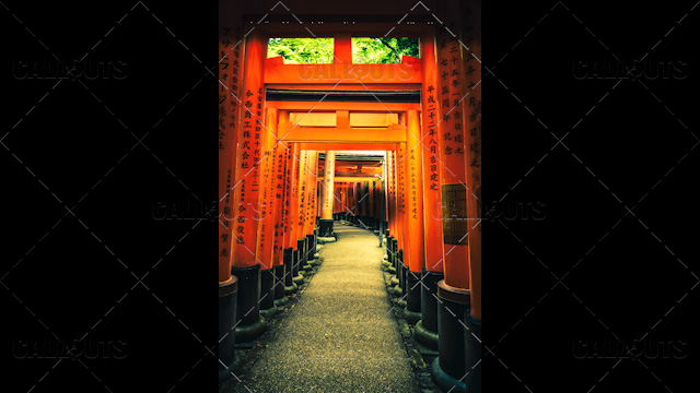 Fushimi Inari-taisha shrine corridor, Orange pillars. Kyoto, Japan.