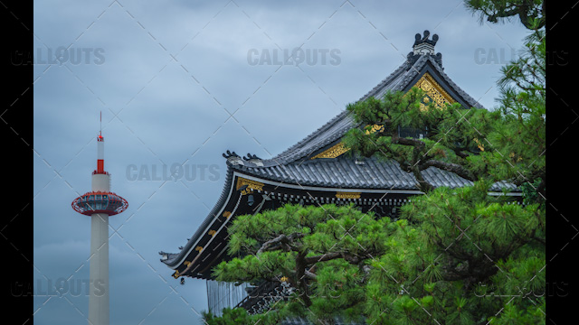 Kyoto tourist attractions. Higashi Hongan-ji Temple roof with Kyoto Tower in the background.