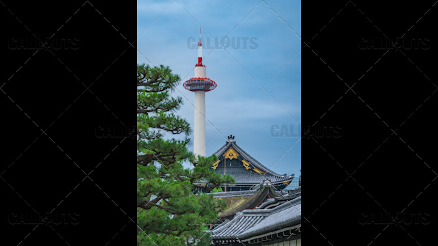 Kyoto tourist attractions. Higashi Hongan-ji Temple roof with Kyoto Tower in the background 02.