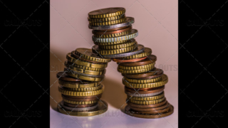 An Unstable Pyramid of Used Coins
