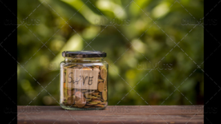 A Jar with Coins with a Save Note Inside, Left