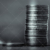 Two Stacks of Coins in Unfair Division Black and White