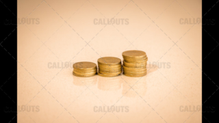Three Stacks of Coins Increasing, on Shiny Table