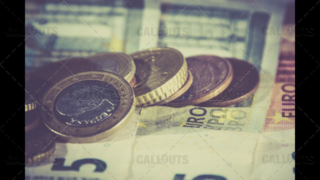Euro Currency Bank Notes and Coins On Top