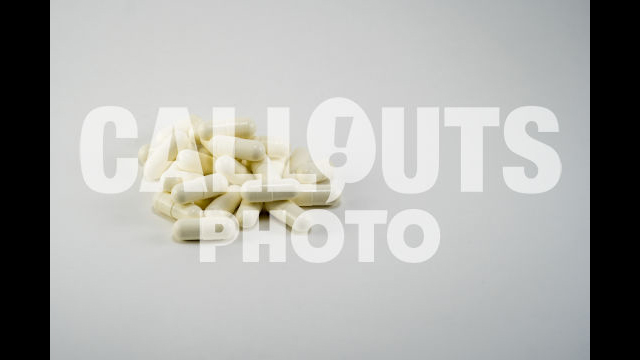 Pile of White Medicine or Supplements, White Background, Text Space