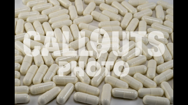 White Medicine or Supplements Covering Entire Image