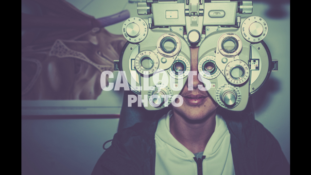 Young Teenage Boy Going Through Eye Exam, Ophthalmic Testing Device, Vintage Styled