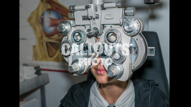 Young Teenage Boy Going Through Eye Exam 02, Ophthalmic Testing Device