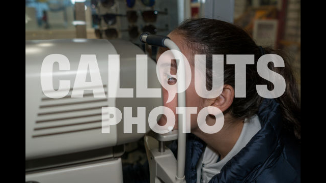 Young Teenage Girl in Eye Exame Checking Eye Vision with Machine 02
