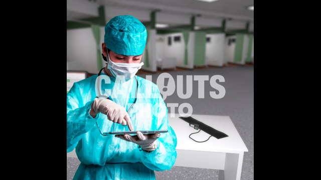 Young Medical Professional with Protective Gear, Holding Tablet, Emergency Ward Background