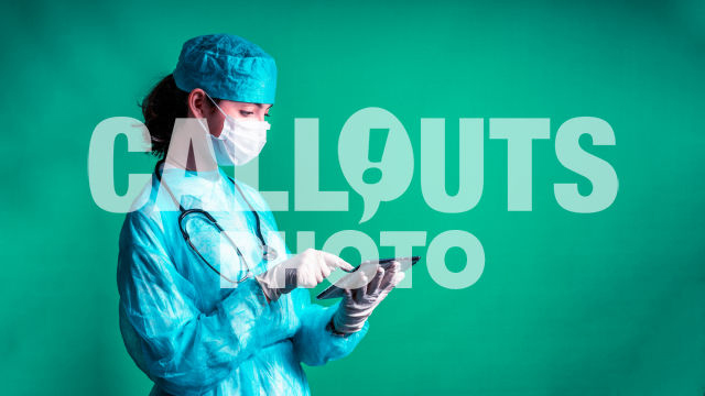Young Medical Professional with Protective Gear, Holding Tablet, Green Background, Text Space