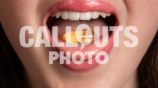 Closeup of Young Womans Mouth Taking Medicine or Supplement, Closeup of Mouth