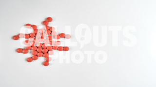 Red Medicine or Supplement Pills Forming Virus Shape on White Background, Text Space