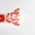 Red Medicine or Supplement Pills Pouring out of Red Bottle, White Background, Text Space