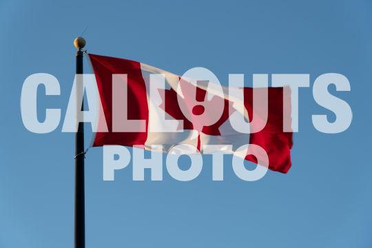 Canadian flag agains blue sky