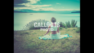 Woman practicing meditation by Cordove Bay