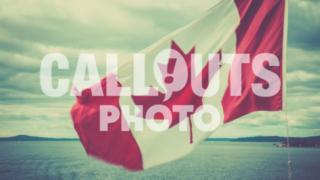 Canadian flag over ocean