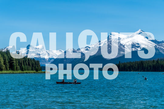 Canoes on Maligne Lake, Mountains and Forest